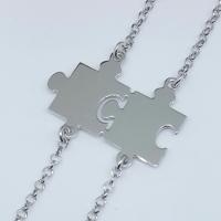 Due bracciali con puzzle divisibile.