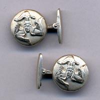 Gemelli in argento raffiguranti la trinacria.