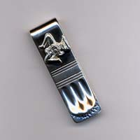 Fermasoldi in argento con l'applicazione della trinacria.