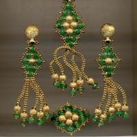 Completo in oro e smeraldi
